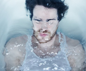 boy, water, and man image