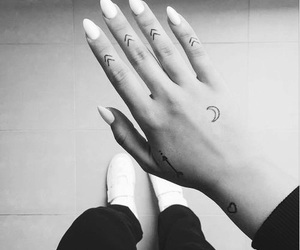 arrow, black and white, and hand image