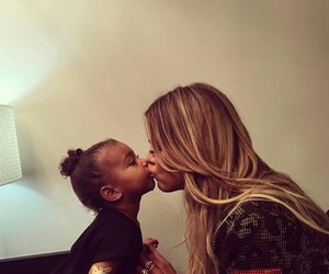 khloe kardashian, north west, and kiss image