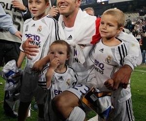 David Beckham, brooklyn beckham, and cruz beckham image
