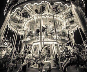 black and white, carousel, and night image