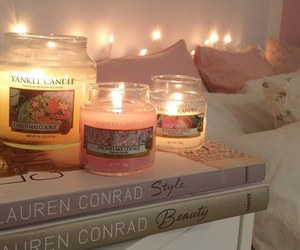 candle, book, and room image