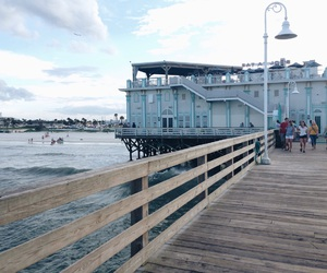 clouds, ocean, and dock image