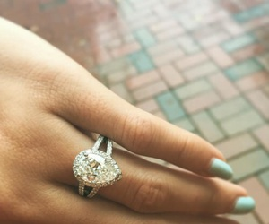 wedding ring, engagement ring, and pear ring image