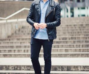 black jacket, black trousers, and blue shorts image