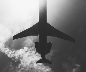 clouds, airplane, and black and white image