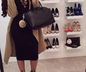 black leather purse, shoe racks, and black curled hair image