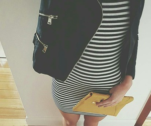 striped dress, black leather jacket, and statement necklaces image