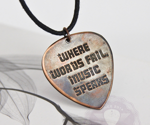 music speaks, guitar pick, and music quotes image