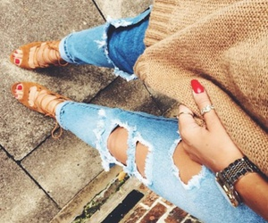 red nails, brown sweater, and silver watch image