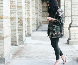 military jacket, beige heels, and black curled hair image