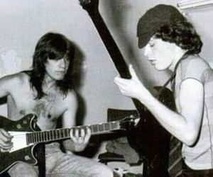 angus young, brothers, and guitars image