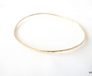 thin 14kt gold bangle, hand hammered gold bangle, and gold stacking bangle image