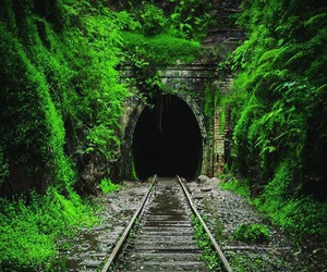 green, railway, and tunnel image