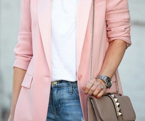 white t-shirt, studded purse, and silver rings image