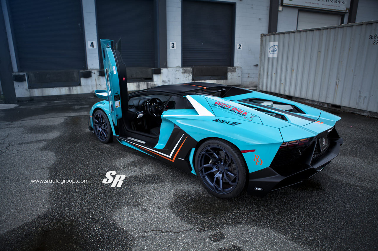 Sr Auto Group Baby Blue Lamborghini Aventador Roadster Rear Three Quarters Door Up