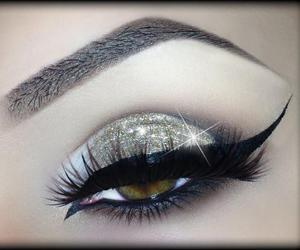 cat eye, eye liner, and glitters image