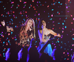 miley cyrus, selena gomez, and concert image