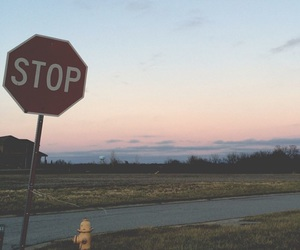 stop, sky, and road image