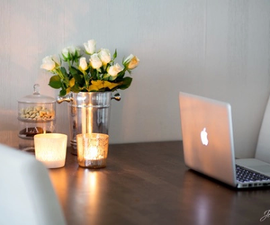 flowers, candle, and apple image