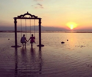 sea, sunset, and swing image