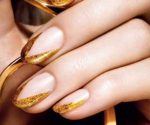 gold, nail lacquer, and nail polish image