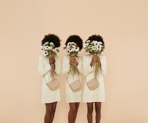 Afro, black woman, and flowers image