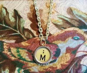 gold chain, letter m, and semicolon image