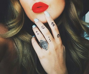 red lips, finger tattoo, and silver ring image