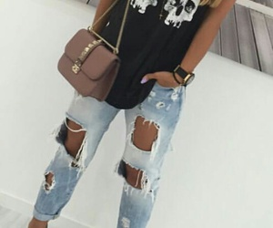 light brown hair, black tank top, and studded purse image