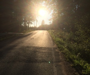 road and sun image