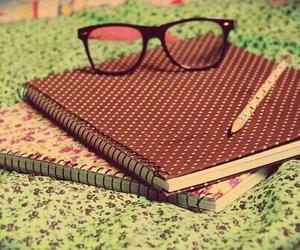 notebook and glasses image
