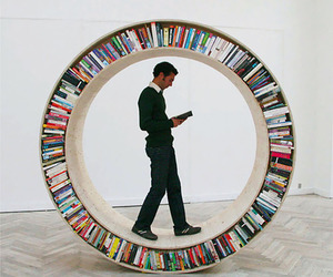 book, bookshelf, and wheel image