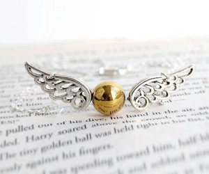book, harry potter, and golden snitch image