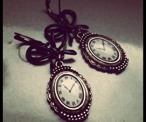 bow tie, clock, and earrings image