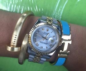 rolex, hermes bracelet, and cartier bracelet image