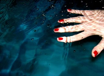 red nails and water image