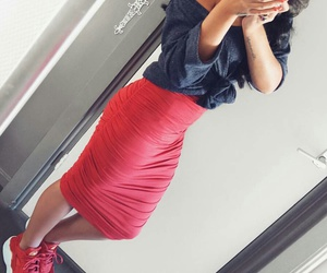 red sneakers, white camera, and red pencil skirts image