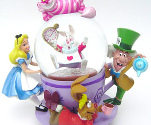 alice in wonderland, snowball, and snowglobe image