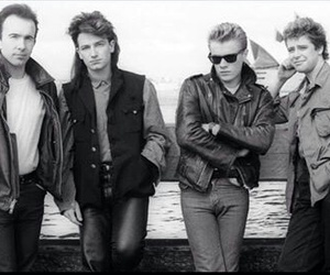 adam clayton, band, and larry mullen jr. image