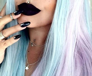 black lips, colored hair, and medusa image