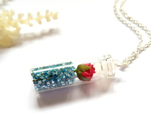 rose necklace, glass vial necklace, and paper rose necklace image