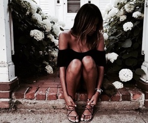 accesories, toned legs, and black jumpsuit image