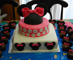 minnie mouse, tiered cake, and marshmallow fondant image
