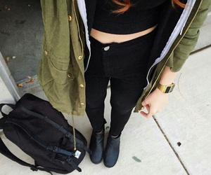 gold watch, black high waisted jeans, and black hoodie image