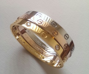 cartier, gold, and bracelet image