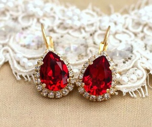 ruby, emerald, and gold image