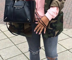 black purse, white sneakers, and wavy black hair image