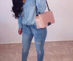 long curled hair, beige pumps, and blue denim jeans image