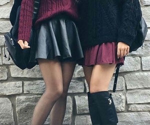 black sweater, black leather boots, and burgundy sweater image